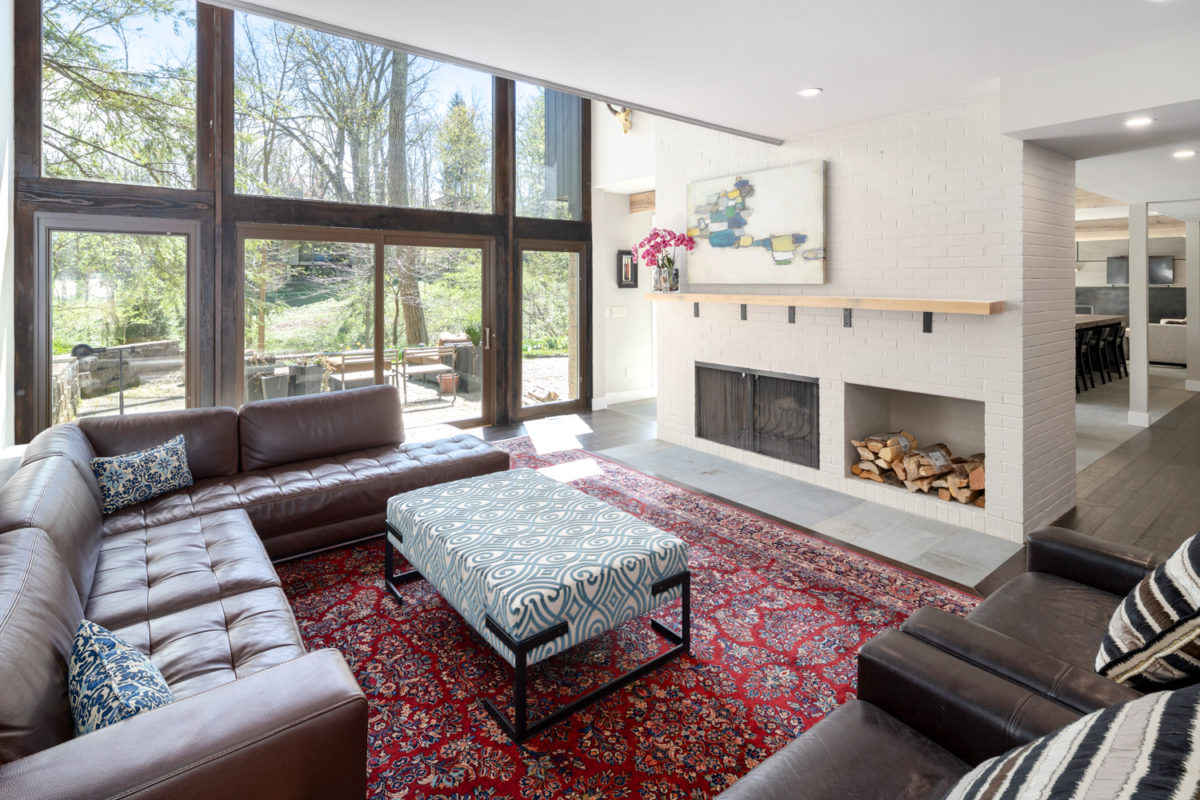 An urban oasis in Hyde Park features a wall of windows and a two-way fireplace in the great room.